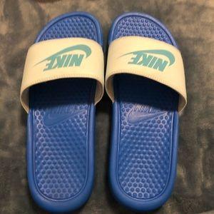 Blue nike slides
